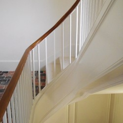 Prestigious and curved wooden custom-made stair realised for villa or luxury house